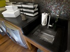 From HGTV's 2012 Green Home- a laundry room sink and counter- wish, wish, wish!