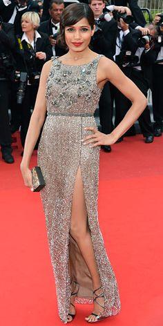 Freida Pinto in silver Sanchita and a Swarovski clutch in Cannes 2013