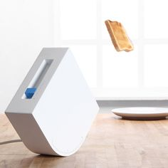Trebuchet Toaster: Set the angle and the force to target your plate.  YES!!! lets do this jetsons style