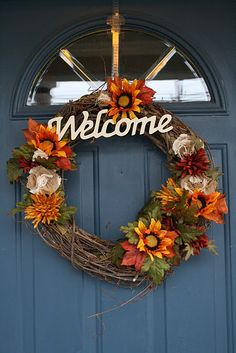 It's a little late, but I made a fall wreath with DIY fabric flowers and crafts store fall flowers.