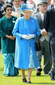 Queen Elizabeth chore a cornflower blue outfit on the day four of Royal Ascot, 2013