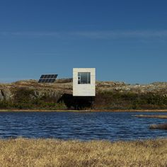 This artist's studio has an angled body that projects out towards a lake.