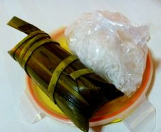 Burmese Wrapped Bananas (Kauknyintok).  Bananas steamed in a banana leaf with coconut cream and sesame seeds.