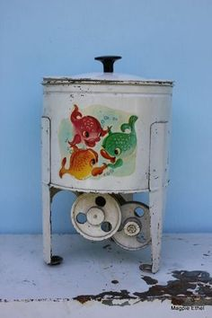 Vintage tin toy washing machine with swimming fishes design. From Magpie Ethel.