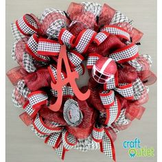 Alabama Houndstooth Deco Mesh Wreath complete with tiny Bear Bryant hat.  CraftOutlet.com offers all the supplies to make this wreath.