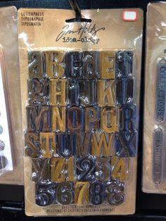 Tim Holtz Ideaology Letterpress Alphabet CHA Winter 2014 - Scrapbook.com  I am going to buy everyone one of these I find!!!!!!!