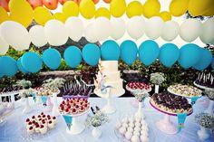 Pinwheel & Balloon Dessert Table by Sweet & Saucy Shop