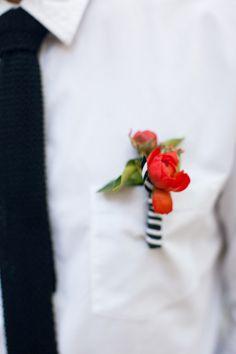 red orange boutonniere with a striped ribbon, photo by She Wanders http://ruffledblog.com/malibu-calamigos-ranch-wedding #weddingideas #boutonnieres
