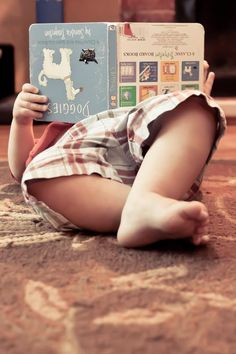 A very young reader. So cute. I remember my kids reading like this...and they still love to read.
