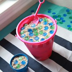 "Simple Sand Pail Cake- layers of cake, pudding, and blackberries with crumbled cake ""sand"" on top. Serve with a shovel. Perfect for a beach/luau/nautical birthday."