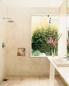 open showers are great for small bathrooms and make it easier to clean