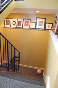 Prints on a staircase....like this idea, not just for stairs; around a room or on one wall in the living room, hallway ...