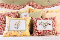 Cottage comfort means a bedful of embroidered pillows, and for us that meant thinking outside the box. We cut the design from a pillowcase kit. Then, we edged it in lace and added it to a cozy throw pillow. The remaining fabric was embroidered with iron-on patterns and cut to size to serve as even more pillowy detail.