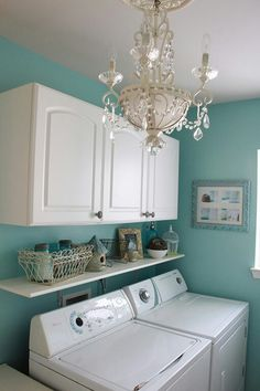 Fancy laundry room. I need to find a vintage chandelier, paint it and hang it in the laundry room. Maybe it'll make me want to do more laundry!!! ;-)