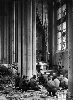 by war correspondent Margaret Bourke-White : American soldiers attend Mass in the bombed cathedral of Cologne. 1945