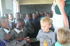 Kids go on cultural visits whilst on safari in Africa.