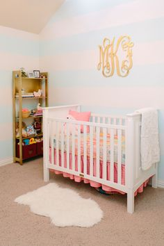 Modern Princess Nursery - love the subtle aqua and white striped walls in this sweet room! {more at projectnursery.com}