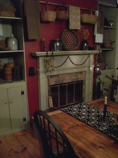 Love the idea of this old wood strip with hanging baskets and folded period cloths. Simple but cute. Above the fire place idea.