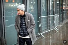 Combine a puffer jacket with a wool coat