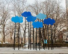 Olaf breuning sets child-like clouds soaring above central park