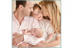 family with newborn pose