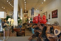 Exposed #log #tables with #red #vases provide the perfect rustic chic combination at #Mecox #Chicago #interiordesign #MecoxGardens #furniture #shopping #home #decor #design #room #designidea #vintage #antiques #garden
