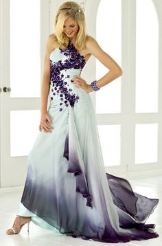 Delicate amethyst rosettes drape down from a soft one shoulder evening dress into sweeps of sky blue ombre chiffon with a full train