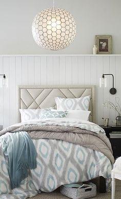 Calming colors & pendant lighting... Love the comforter!