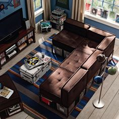 Large Lounge Entertainment With Brown L Shaped Sofa And White Trunk Above Striped Area Rug