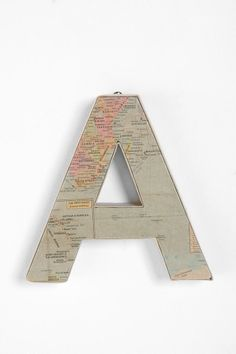 Love this idea! Using old maps to decorate cardboard letters from Michaels - would be fun above a desk in our office area