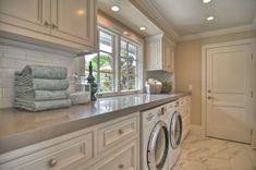 Gray laundry room.