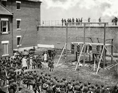 "July 7, 1865. ""Washington, D.C. Hanging hooded bodies of the four conspirators; crowd departing."" Lincoln assassination conspirators Mary Surratt, Lewis Payne, David Herold and George Atzerodt shortly after their execution at Fort McNair"