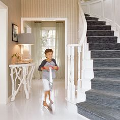 White painted floors with a blue striped runner