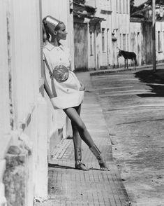 Veruschka models a white mini-dress with aluminum accessories in the Caribbean, 1968 #vogue365