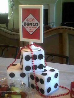 Bunco Table Decorations/// such an easy diy! styrofoam cubes, black felt...the sign could be done with a frame and candlestick or similar