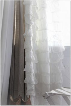 love the layered look of the ruffle curtains paired with the burlap and white muslin.