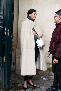 Giovanna Battaglia in an amazing cape and jeweled loafers