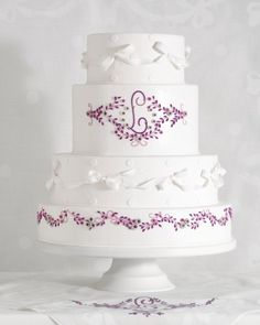 The lilac flowers are molded sugar paste, and the monogram and stems are piped royal icing. See more handkerchief inspired wedding cakes.