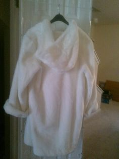 Beautiful winter white hooded sheared faux fur coat for sale .  3/4 length  size  large will fit cuddly  priced to sell fast $100   does not include shipping ..serious inquiries  only please call 843-901-2062