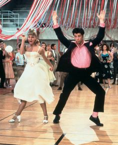 Of course, Grease – everybody hand jive! Sandy's primrose prom dress is the stuff of dreams.