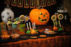 Halloween Party Table with a pumpkin pinata!  #halloween #partytable
