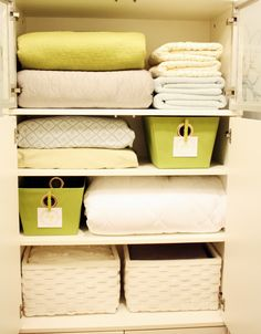 On the second shelf, those fabrics are pillowcases, stuffed with the matching folded sheet sets. Amazing. No searching for matching sets when they're all packaged together!