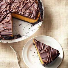 Decadent chocolate glaze adds something extra to this Pumpkin Pie Cheesecake. Recipe: http://www.bhg.com/recipe/chocolate-glazed-pumpkin-pie-cheesecake/?socsrc=bhgpin082012PumpkinPieCheesecake