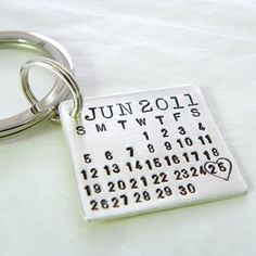 Groom's keychain. So he can never forget your anniversary. lol, cute.
