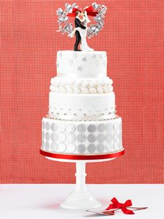 A cute bride and groom cake topper is a must for a retro Fifties feel.(: