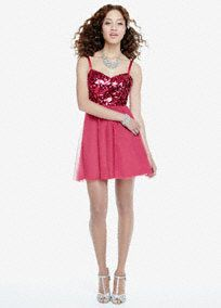Dramatic is an understatement, you will shine in this stunning sequin homecoming dress!  Spaghetti strap sweetheart bodice features dazzling sequin detail and eye-catching X back.  Full tulle skirt is fun, flirty and perfect for dancing the night away.  Fully lined. Back zip. Imported polyester. Spot clean.