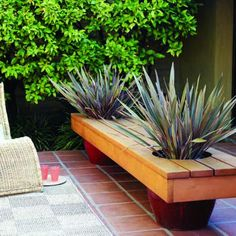 Modern planter bench: Instead of legs, this 10-foot-long bench sits on a pair of oversize ceramic pots.