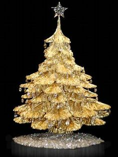 This is the World's Most Expensive Christmas Tree and valued at over half a million dollars. This tree is made from 5 pounds of 18 karat gold, is decorated with round briolette diamonds, and has a platinum star with a 4.54 karat diamond on top. S)