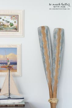 Creatively painted oars. More ideas on CC:  http://www.completely-coastal.com/2011/03/painted-oars-diy-or-buy.html