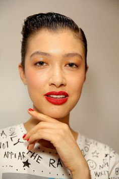 Bold red nails matched the model's bright lips at Zac Posen.